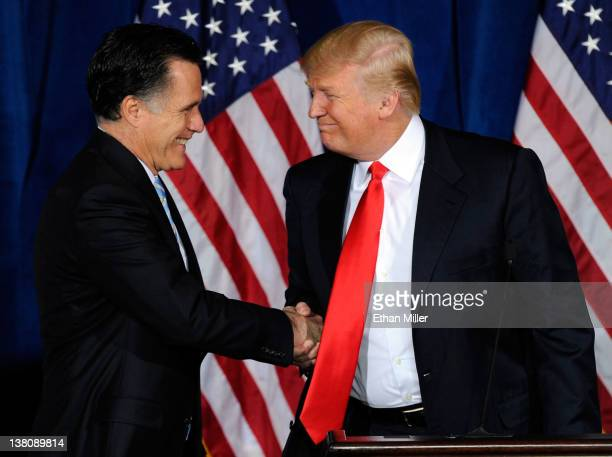 Republican presidential candidate former Massachusetts Gov Mitt Romney and Donald Trump shake hands during a news conference held by Trump to endorse...