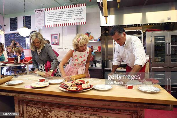 Republican presidential candidate former Massachusetts Gov Mitt Romney and his wife Ann Romney roll out pie shells with the help of Sweetielicious...