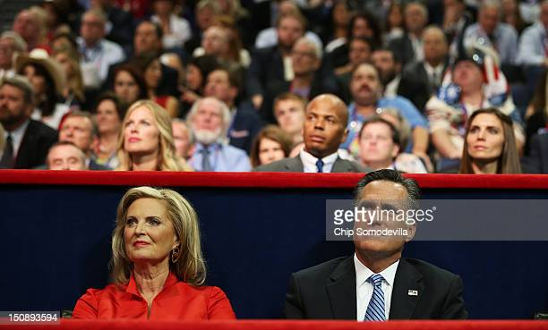 Republican presidential candidate former Massachusetts Gov Mitt Romney and his wife Ann Romney listen as New Jersey Gov Chris Christie delivers the...