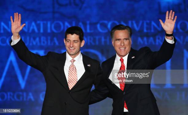 Republican presidential candidate former Massachusetts Gov Mitt Romney and Republican vice presidential candidate US Rep Paul Ryan wave on stage...