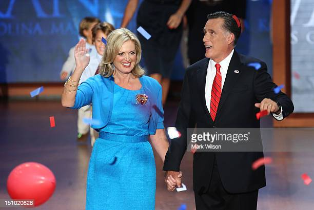 Republican presidential candidate former Massachusetts Gov Mitt Romney and his wife Ann Romney stand on stage as balloons drop after accepting the...