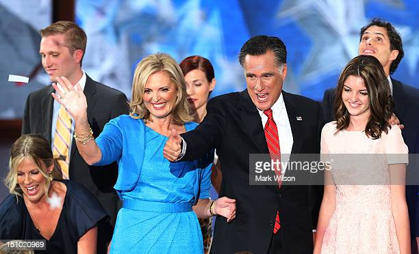 Republican presidential candidate former Massachusetts Gov Mitt Romney and his wife Ann Romney stand on stage with their family after accepting the...