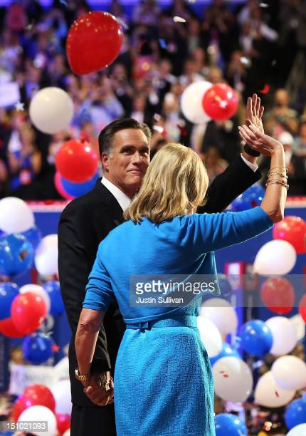 Republican presidential candidate former Massachusetts Gov Mitt Romney and his wife Ann Romney wave on stage after accepting the nomination during...