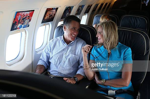Republican presidential candidate former Massachusetts Gov Mitt Romney and his wife Ann Romney talk on the campaign plane on September 1 2012 en...
