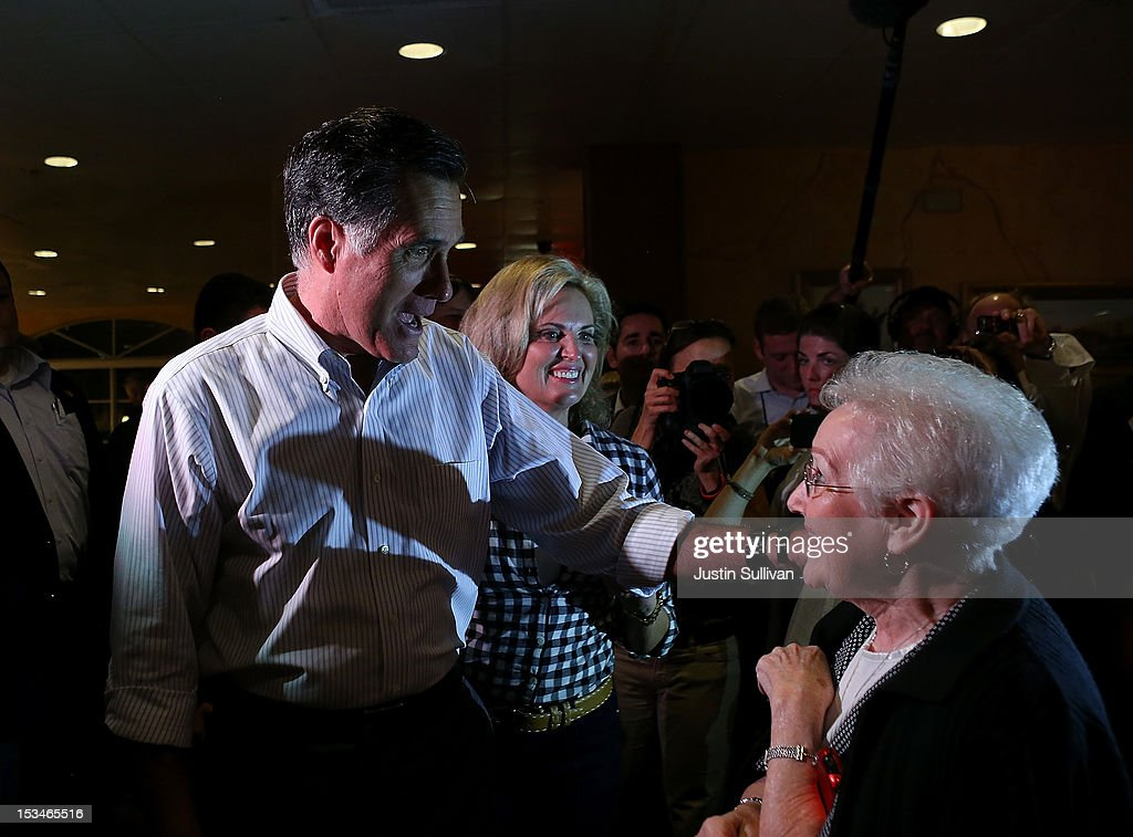 Republican presidential candidate, former Massachusetts Gov. Mitt Romney (L) and his wife Ann Romney (C) greet diners at Capedevila's at La Teresita restaurant on October 5, 2012 in Tampa, Florida. Mitt Romney is campaigning in Virginia coal country and in Florida.