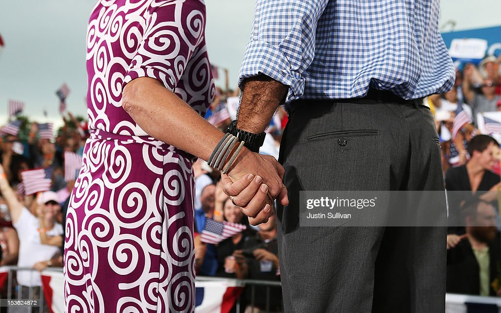 Republican presidential candidate, former Massachusetts Gov. Mitt Romney (R) and his wife Ann Romney hold hands during a victory rally at Tradition Town Square on October 7, 2012 in Port St. Lucie, Florida. Mitt Romney is campaigning in Florida before traveling to Virginia where he is scheduled to give a foreign policy speech at the Virginia Military Institute.