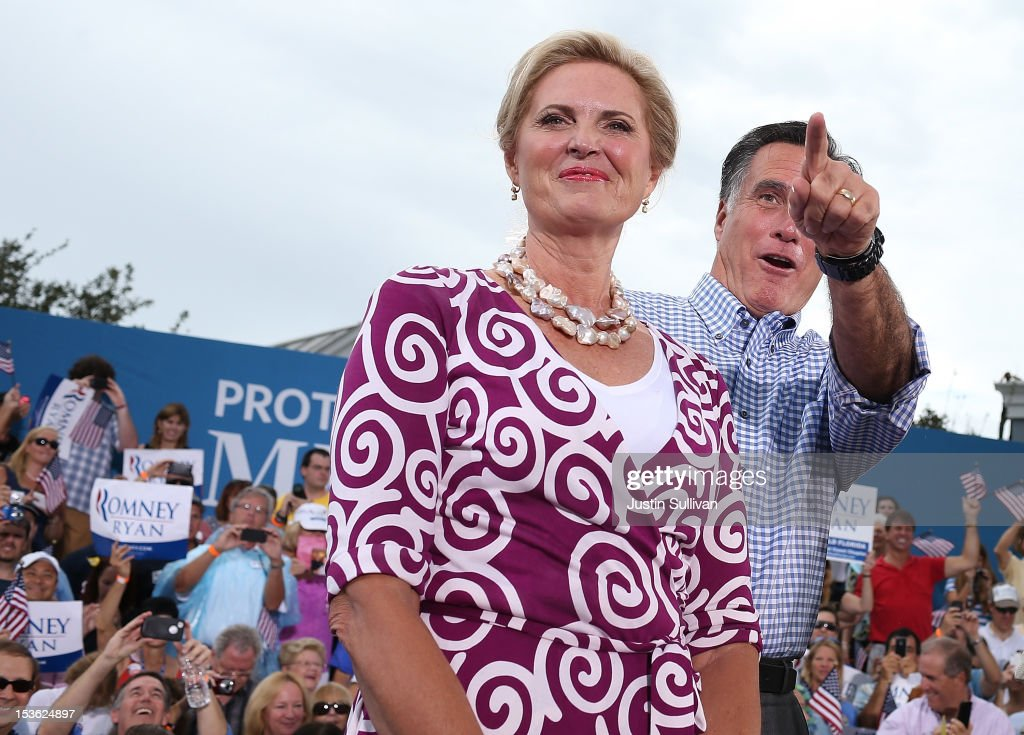 Republican presidential candidate, former Massachusetts Gov. Mitt Romney (R) and his wife Ann Romney look on during a victory rally at Tradition Town Square on October 7, 2012 in Port St. Lucie, Florida. Mitt Romney is campaigning in Florida before traveling to Virginia where he is scheduled to give a foreign policy speech at the Virginia Military Institute.