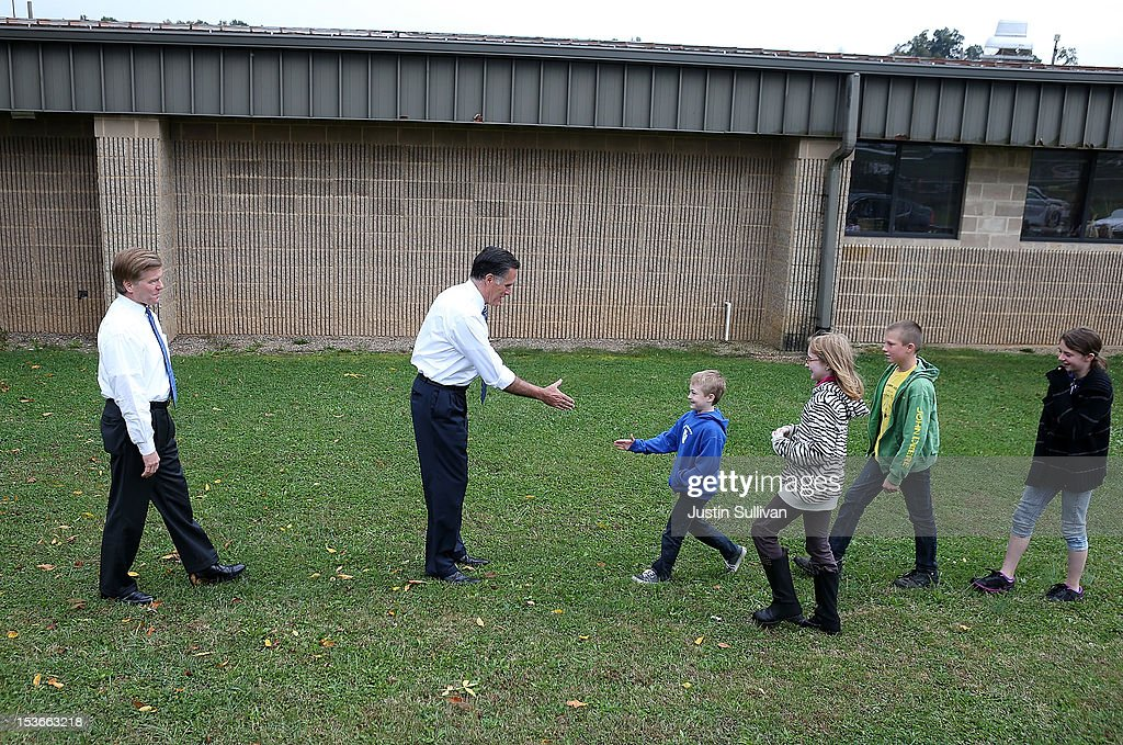 Republican presidential candidate, former Massachusetts Gov. Mitt Romney (C) and Virginia Governor Bob McDonnell (L) greet students at Fairfield Elementary school after he delivered a foreign policy speech at the Virginia Military Institute on October 8, 2012 in Fairfield, Virginia. Mitt Romney is campagning in Virginia.