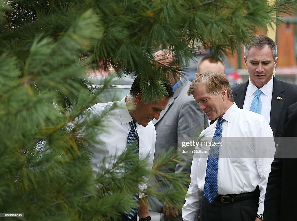Republican presidential candidate, former Massachusetts Gov. Mitt Romney (L) and Virginia Governor Bob McDonnell (R) talk behind a tree before greeting students at Fairfield Elementary school after he delivered a foreign policy speech at the Virginia Military Institute on October 8, 2012 in Fairfield, Virginia. Mitt Romney is campagning in Virginia.