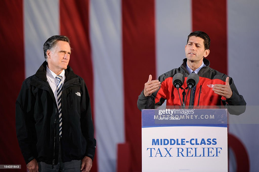 Republican presidential candidate, former Massachusetts Gov. Mitt Romney (L) and Republican vice presidential candidate, U.S. Rep. Paul Ryan (R-WI) speak on stage at a rally on October 12, 2012 in Lancaster, Ohio. The two were campaigning a day after Ryan's debate with U.S. Vice President Joe Biden.