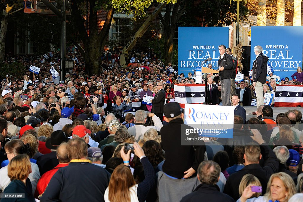 Republican presidential candidate, former Massachusetts Gov. Mitt Romney and Republican vice presidential candidate, U.S. Rep. Paul Ryan (R-WI) speak to a crowd at the town square on October 12, 2012 in Lancaster, Ohio. The two were campaigning a day after Ryan's debate with U.S. Vice President Joe Biden.