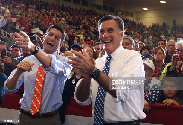 Republican presidential candidate former Massachusetts Gov Mitt Romney and his running mate US Sen Paul Ryan laugh as they watch a performance by the...