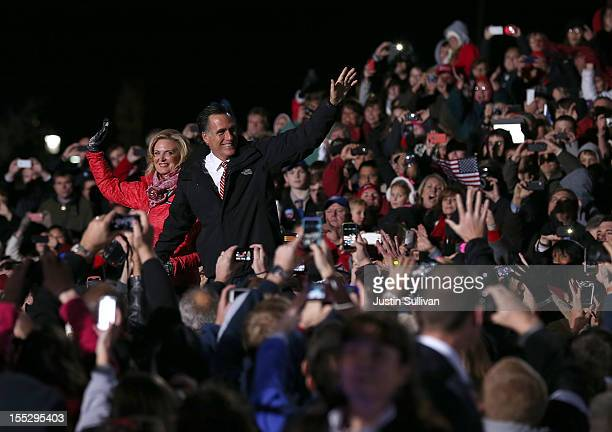 Republican presidential candidate former Massachusetts Gov Mitt Romney and his wife Ann Romney greet supporters during a campaign rally at The Square...
