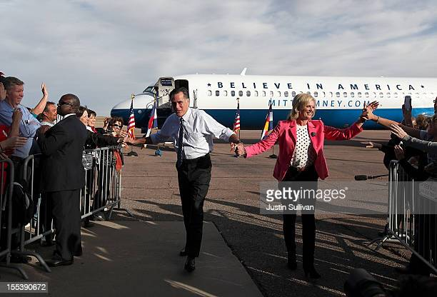 Republican presidential candidate former Massachusetts Gov Mitt Romney and his wife Ann Romney greet supporters during a campaign rally at Colorado...