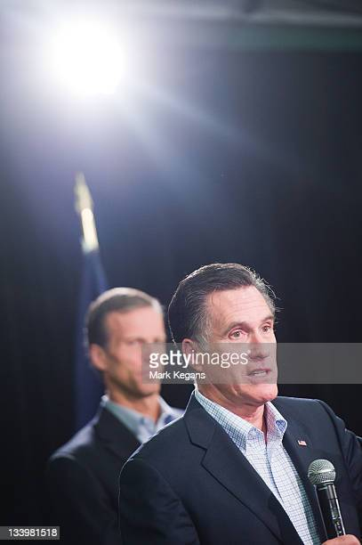 Republican presidential candidate former Massachusetts Gov. Mitt Romney speaks as U.S. Sen. John Thune stands by during an appearance before...