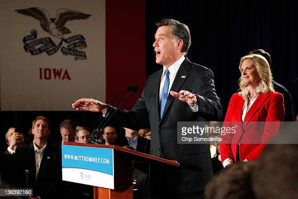 Republican presidential candidate former Massachusetts Gov Mitt Romney speaks as his wife Ann Romney looks on at the Hotel Fort Des Moines on the...