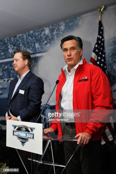 Republican presidential candidate former Massachusetts Gov Mitt Romney speaks as Brian France CEO and chairman of NASCAR looks on during a CEO...