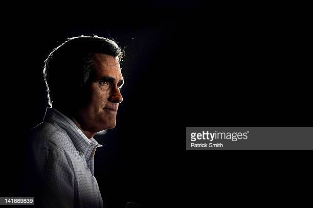 Republican presidential candidate former Massachusetts Gov Mitt Romney addresses supporters as he campaigns during a town hall forum at the American...