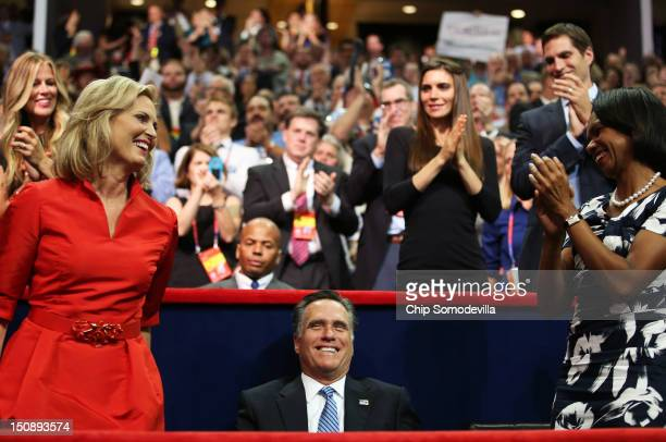 Republican presidential candidate former Massachusetts Gov Mitt Romney watches as his wife Ann Romney and former US Secretary of State Condoleezza...