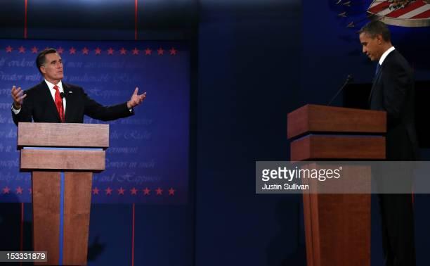 Republican presidential candidate former Massachusetts Gov Mitt Romney speaks as Democratic presidential candidate US President Barack Obama listens...
