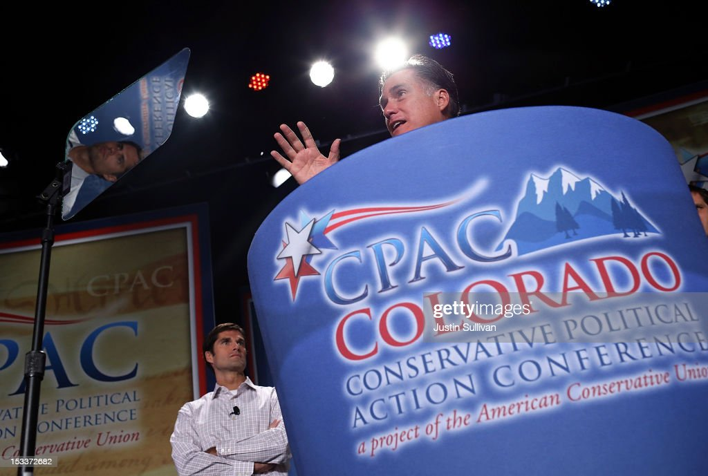 Republican presidential candidate, former Massachusetts Gov. Mitt Romney speaks as his son Matt Romney looks on during the regional Conservative Political Action Conference (CPAC) on October 4, 2012 in Denver, Colorado. One day after the first presidential debate, Mitt Romney spoke to the CPAC before heading to Virginia to campaign with his running mate Rep. Paul Ryan (R-WI).
