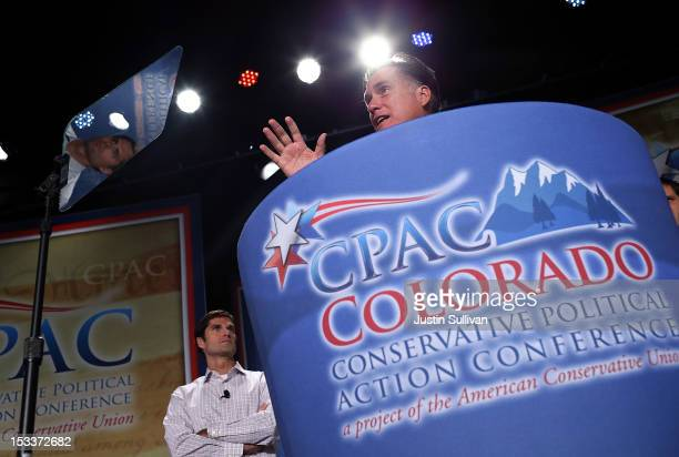 Republican presidential candidate former Massachusetts Gov Mitt Romney speaks as his son Matt Romney looks on during the regional Conservative...
