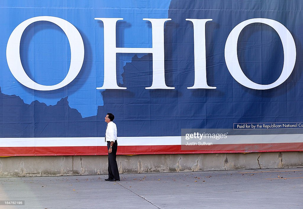 Republican presidential candidate, former Massachusetts Gov. Mitt Romney looks at a large banner during a campaign rally at Worthington Industries on October 25, 2012 in Cincinnati, Ohio. Mitt Romney is campaigning in Ohio with less than two weeks to go before the election.