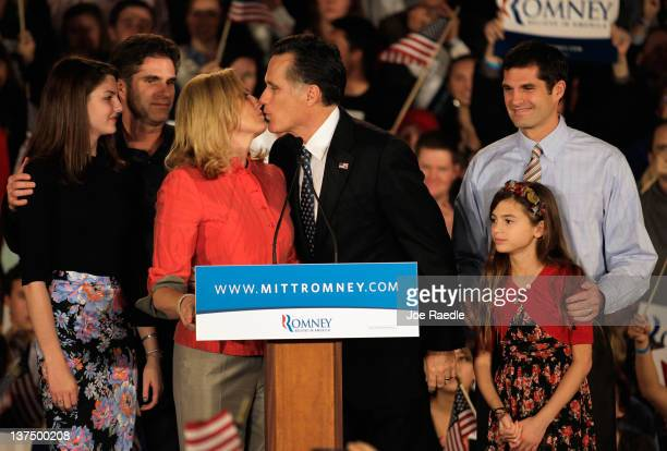 Republican presidential candidate former Massachusetts Gov Mitt Romney kisses his wife Ann Romney while surrounded by his son's and grand children...