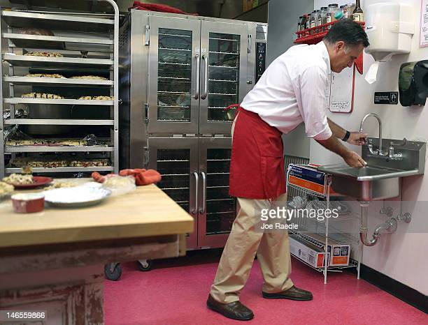 Republican presidential candidate former Massachusetts Gov Mitt Romney washes his hands after rolling out a pie shell at Sweetielicious Bakery Café...