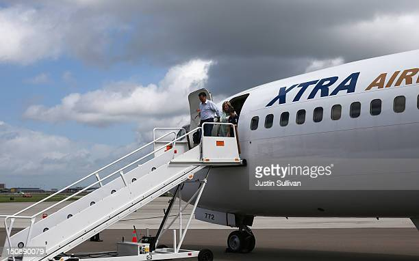 Republican presidential candidate former Massachusetts Gov Mitt Romney exits his plane with wife Ann Romney before attending the Republican National...