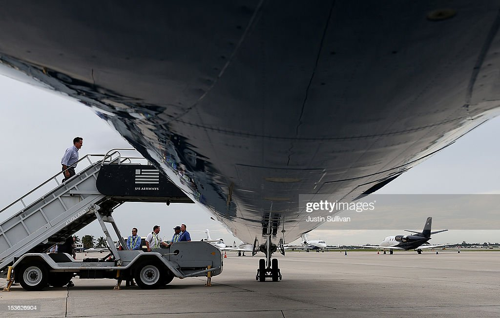 Republican presidential candidate, former Massachusetts Gov. Mitt Romney boards his campaign plane on October 7, 2012 in Palm Beach, Florida. Mitt Romney is campaigning in Florida before traveling to Virginia where he is scheduled to give a foreign policy speech at the Virginia Military Institute.