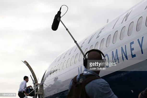 Republican presidential candidate, former Massachusetts Gov. Mitt Romney boards his campaign plane at Newark Liberty International Airport on October...