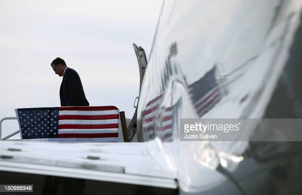 Republican presidential candidate former Massachusetts Gov Mitt Romney walks off of his campaign plane on August 29 2012 in Tampa Florida As the...