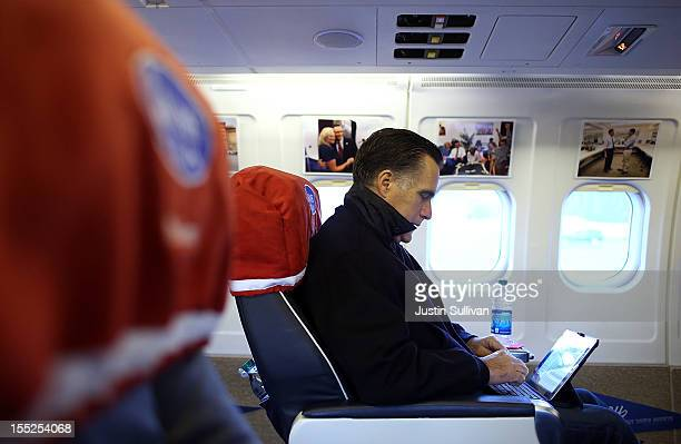 Republican presidential candidate former Massachusetts Gov Mitt Romney works on his iPad aboard his campaign plane before take off on November 2 2012...