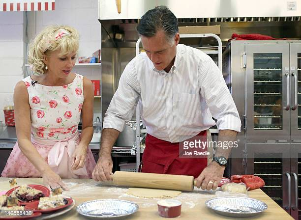 Republican presidential candidate former Massachusetts Gov Mitt Romney rolls out a pie shell with the help of Sweetielicious Bakery Café store owner...