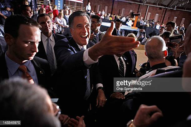 Republican presidential candidate former Massachusetts Gov Mitt Romney shakes hands with supporters during a campaign rally titled A Better America...