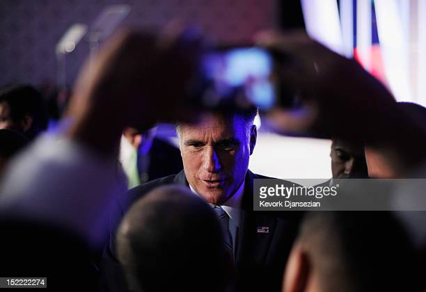 Republican presidential candidate former Massachusetts Gov Mitt Romney greets supporters after addressing the US Hispanic Chamber of Commerce's 33rd...