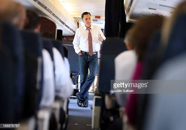 Republican presidential candidate former Massachusetts Gov Mitt Romney talks with members of his staff aboard his campaign plane at Denver...