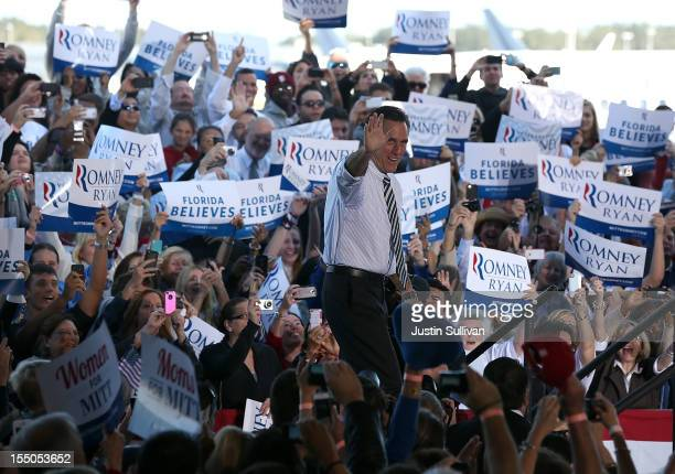 Republican presidential candidate former Massachusetts Gov Mitt Romney greets supporters during campaign rally at Tampa International Airport on...
