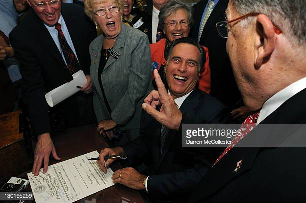 Republican presidential candidate former Massachusetts Gov Mitt Romney files the paperwork necessary to be on the New Hampshire primary ballot...