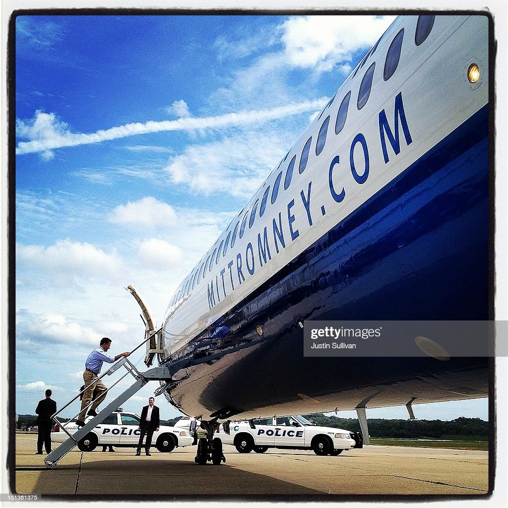 Republican presidential candidate, former Massachusetts Gov. Mitt Romney (C), boards the campaign plane on September 1, 2012 in Cincinnati, Ohio. Mitt Romney will hold campaign events in Ohio and Florida.