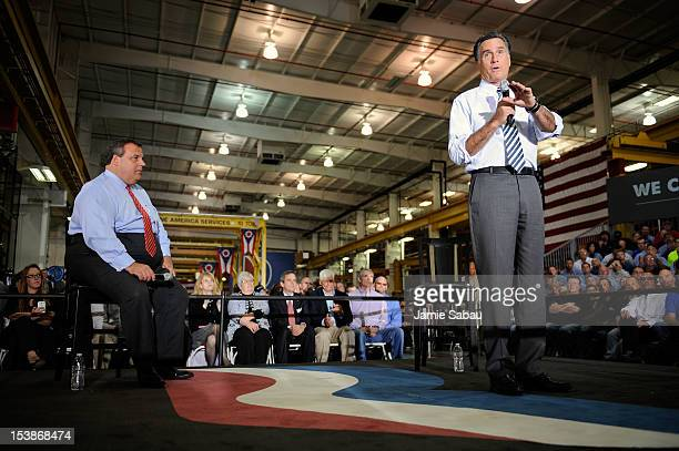 Republican presidential candidate former Massachusetts Gov Mitt Romney addresses the crowd as New Jersey Gov Chris Christie listens at Ariel...