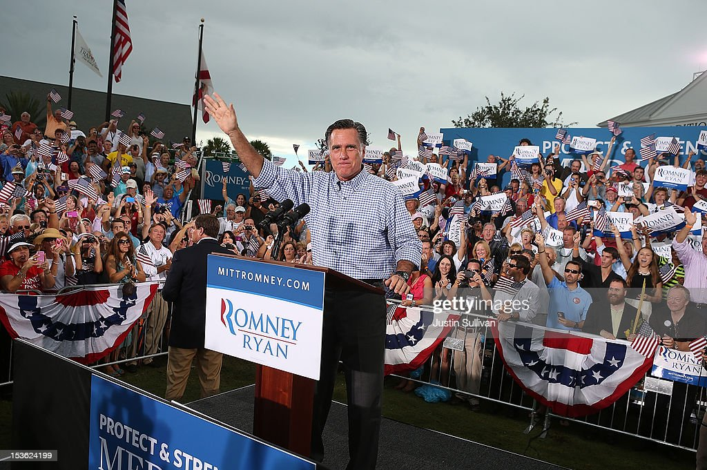 ER 07: Republican presidential candidate, former Massachusetts Gov. Mitt Romney waves to supporters during a rally at Tradition Town Square on October 7, 2012 in Port St. Lucie, Florida. Romney is campaigning in Florida before traveling to Virginia where he is scheduled to give a foreign policy speech at the Virginia Military Institute.