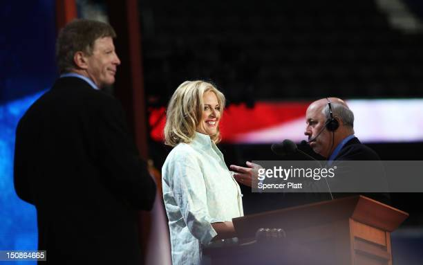 Republican presidential candidate former Massachusetts Gov Mitt Romney's wife Ann Romney stands on stage with stage manager Howard Kolins for a...