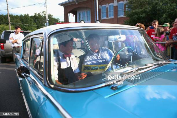 Republican presidential candidate former Massachusetts Governor Mitt Romney sits in a 1961 Rambler owned by Michael Scheib during a campaign event at...