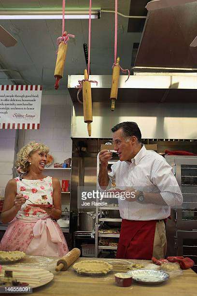 Republican Presidential candidate former Massachusetts Governor Mitt Romney samples a cherry pie as Sweetielicious Bakery Café store owner Linda...