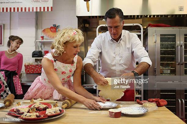 Republican Presidential candidate former Massachusetts Governor Mitt Romney makes a pie shell with the help of Sweetielicious Bakery Café store owner...