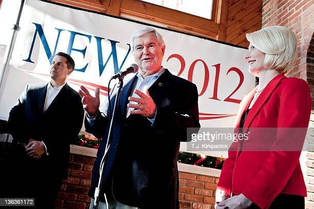 Republican presidential candidate former Speaker of the House Newt Gingrich speaks at a campaign stop with his wife Callista Gingrich to bolster...