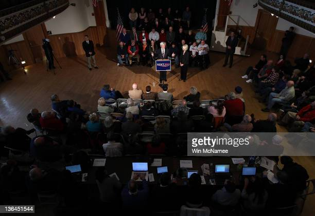 Republican presidential candidate former Speaker of the House Newt Gingrich speaks as his wife Callista looks on during a town hall meeting at...