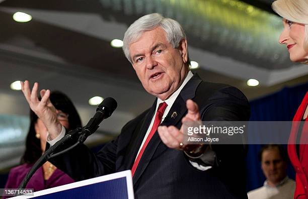 Republican presidential candidate former Speaker of the House Newt Gingrich speaks at his party on primary night as his wife Callista Gingrich looks...